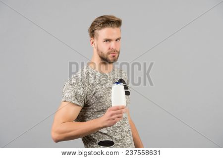 Man With Shampoo Or Gel Bottle In Hand. Macho With Stylish Hair, Haircut. Skincare, Hair Care, Healt