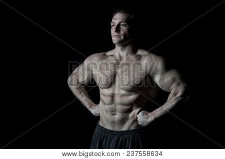 Man Athlete With Fit Torso Muscles. Bodybuilder With Six Pack And Ab. Sportsman Show Biceps And Tric