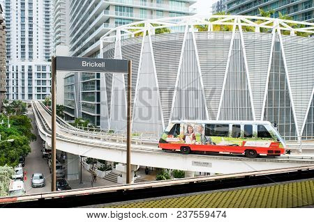 Miami, Usa - October 30, 2015: Train Arrive At Brickell Station With Downtown Skyscrapers On Urban B