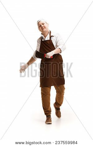 Smiling Happy Butcher Going Isolated On White Studio Background. The Young Caucasian Male Model In F