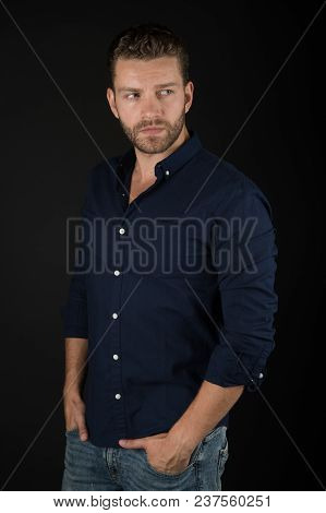 Bearded Man In Blue Shirt And Jeans. Macho With Beard And Stylish Hair. Guy In Casual Outfit. Fashio