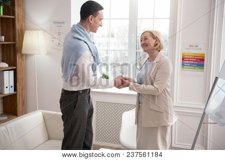 Business Deal. Professional Two Colleagues Greeting While Standing