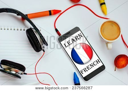 Smartphone With French Flag And Headphones. Concept Of French Learning Through Audio Courses