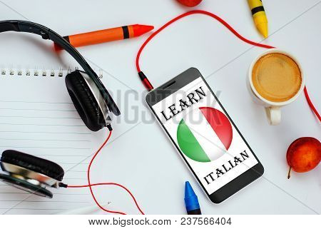 Smartphone With Italian Flag And Headphones. Concept Of Italian Learning Through Audio Courses