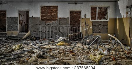 Abandoned Building Interior. Room In The Ruined Abandoned Building. Grunge Architectural Background.
