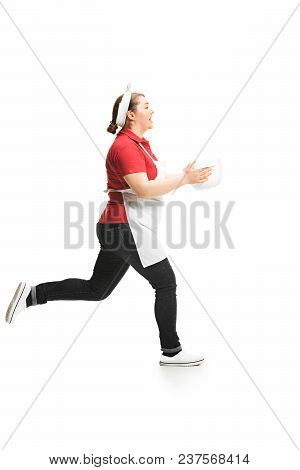 Portrait Of Cute Smiling Woman With Bowl In Her Hands Running In The Studio, Isolated On White Backg