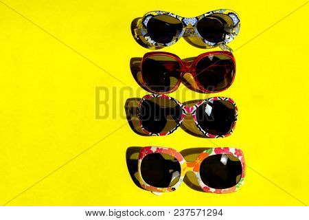 Travel, Vacation, Summer And Sale Background. Close-up Shot Of Sunglasses. Sunglasses On Yellow Back