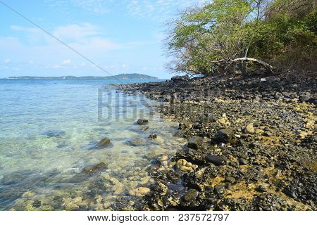 Koh Hin Ngam  Is A Unique Small Island Unlike Other Island. It's Covered With Small Black Rocks