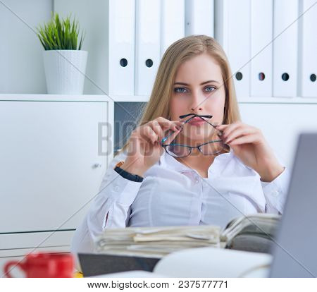 Confident Business Lady. Beautiful Young Woman In Formalwear Holding A Paper And Adjusting Glasses W