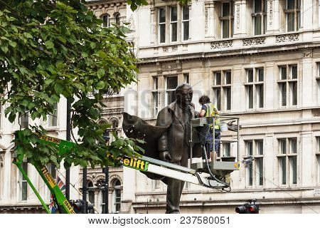 London, United Kingdom - July 31, 2017: Employees Of The City Service Clean The David Lloyd George M