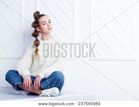 Beautiful little fashion model on white background. Portrait of cute smiling girl posing in studio