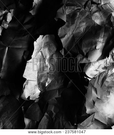 crumpled black and white paper, background
