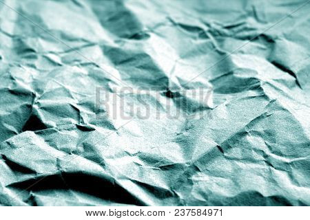 Old Paper With Wrinckles In Cyan Color. Abstract Background And Texture For Design.
