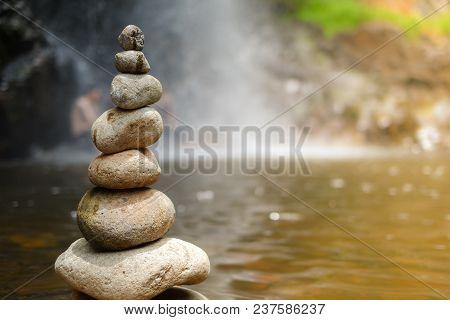 Pebble On Waterfall. Royalty High Quality Free Stock Of Stones Pyramid On Pebble Waterfall Symbolizi