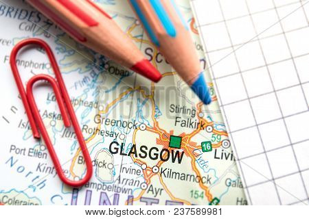 Glasgow City Of Great Britain In The Center Of The Geographic Map, Pencils And Paper Sheet