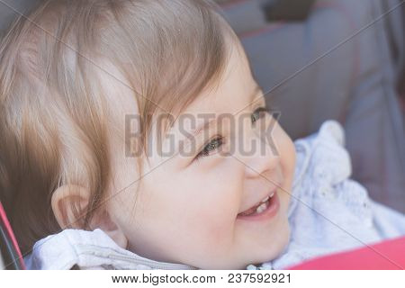 Lovely Happy Child Laughing. Close-up Portrait Outdoors