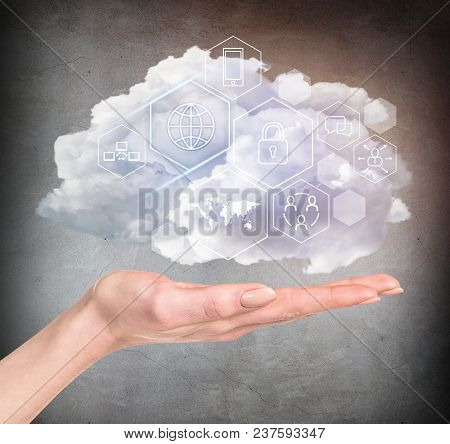 Hand Holding Cloud With Different Digital Icons. Technology Concept.