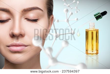 Cosmetic Primer Oil Near Woman Face With Big Molecule Chain. Beauty Therapy Concept.