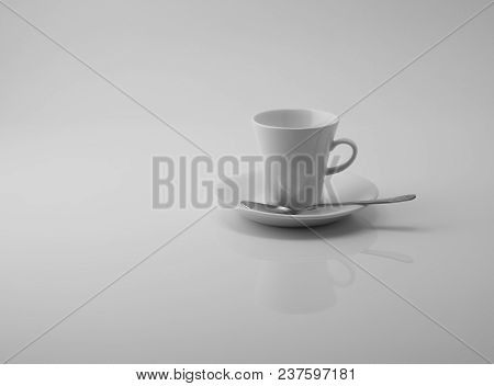 Empty White Cup Reflecting In White Surface On White Background With Space For Your Text.