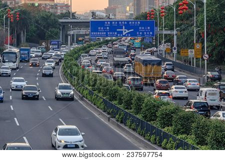 China, Shenzhen, 2018-03-09: Evening Traffic In Big City, Cars On Divided Highway Road, Traffic Jam