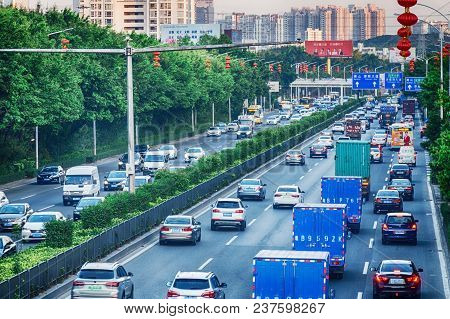 China, Shenzhen, 2018-03-09: Day Traffic, Peak Hour In Big Town, Jam From Many Cars On Divided Highw