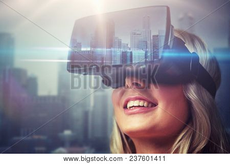 technology, augmented reality, entertainment and people concept - close up of young woman with virtual headset or 3d glasses over singapore city skyscrapers background