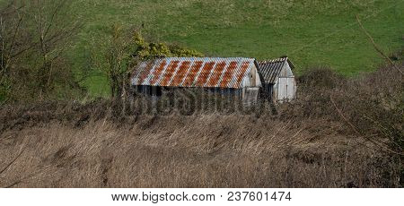 Photo Of A Two Old And Neglected Sheds