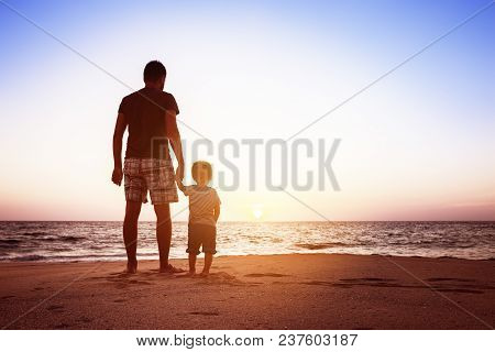 Father And Son Beach Sunset Holidays Concept