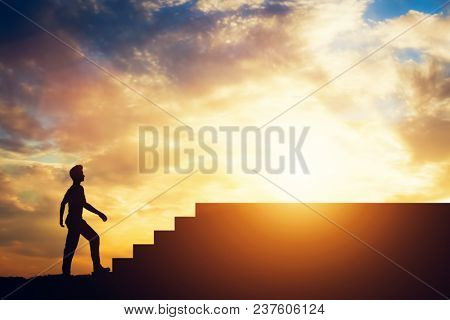 Man standing in front of stairs. Aspiration and ambition. Overcoming obstacles.