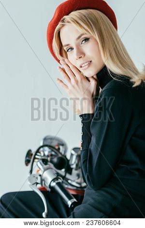 Smiling Blonde Girl In Red Beret Posing By Vintage Scooter Isolated On Grey
