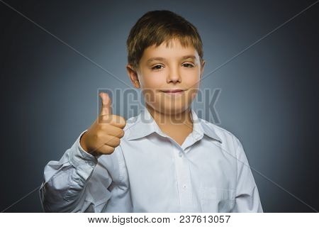Closeup Portrait Successful Happy Boy Isolated Grey Background. Positive Human Emotion Face Expressi