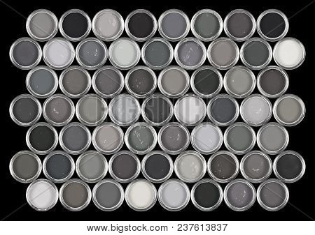 Arrangement Of Tins Of Paint / Ink In Shades Of Grey.