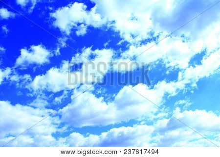 Beautiful White Clouds On Blue Sky Background. White Clouds On Summer Sky. Cloudy Heaven