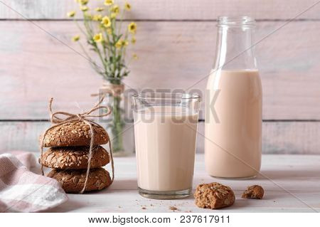 Baked Milk With Oatmeal Cookies And Flowers