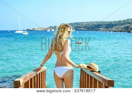 Woman At The Beach In Cyprus. Beautiful Summer Seaside View