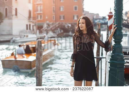 Travel Tourist Girl On Vacation Walking Happy By Grand Canal. Attractive Young Romantic Woman Smilin