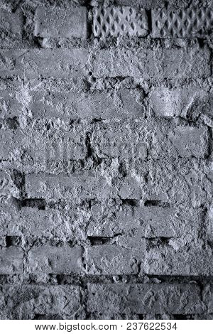 Old Dirty Wall Brick Wall. Background Backdrop Texture. Black And White Photo