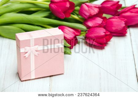 Tulip Bouquet And Small Gift Box On White Wooden Background, Copy Space