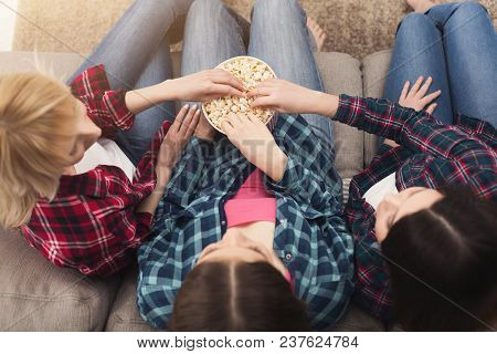 Three Women Eating Popcorn And Watching Movie At Home, Female Friends Having Rest After Hard Week, T