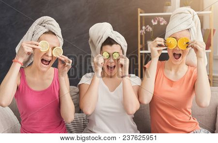 Three Beautiful Girls In Colourful Clothes And With Towels On Heads Having Fun, Covering Eyes With L