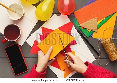 Birthday Handmade Background. Female Hands Making Party Paper Decorations And Colorful Flags Garland