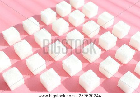 Refined Sugar On Pink Background.cubes Of Sweet And White Sugar In Geometricshape. Hard Shadows And