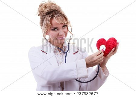 Medical Examination Of Cardiology. Middle Aged Cardiologist With Heart And Stethoscope. Female Docto