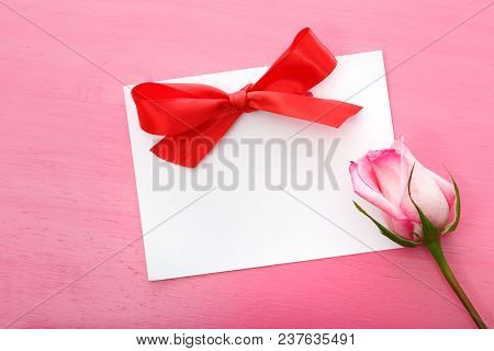 Rose With Greeting Card On A Pink Background