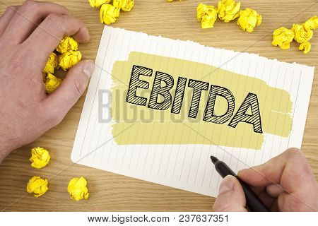 Writing Note Showing  Ebitda. Business Photo Showcasing Earnings Before Tax Is Measured To Evaluate