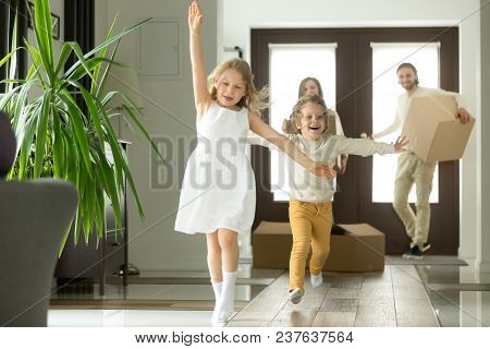 Excited Funny Kids Boy And Girl Running Inside Luxury Big Modern House On Moving Day, Cute Children