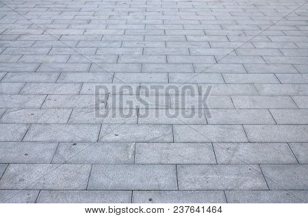 Fragment Of The Square Paved Of A Large Granite Tiles