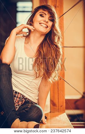 Happy Cute Pretty Gorgeous Woman Sitting On Floor At Home. Attractive Young Girl With Long Hair Wear