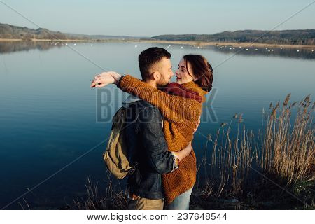 Travel And Love. Happy Young Couple Traveling Near The Blue Bay