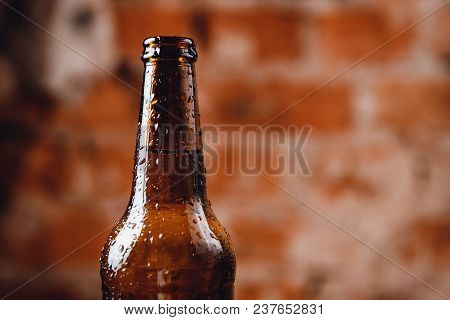 Brown Ice Bottle Glass Background Brick Wall.